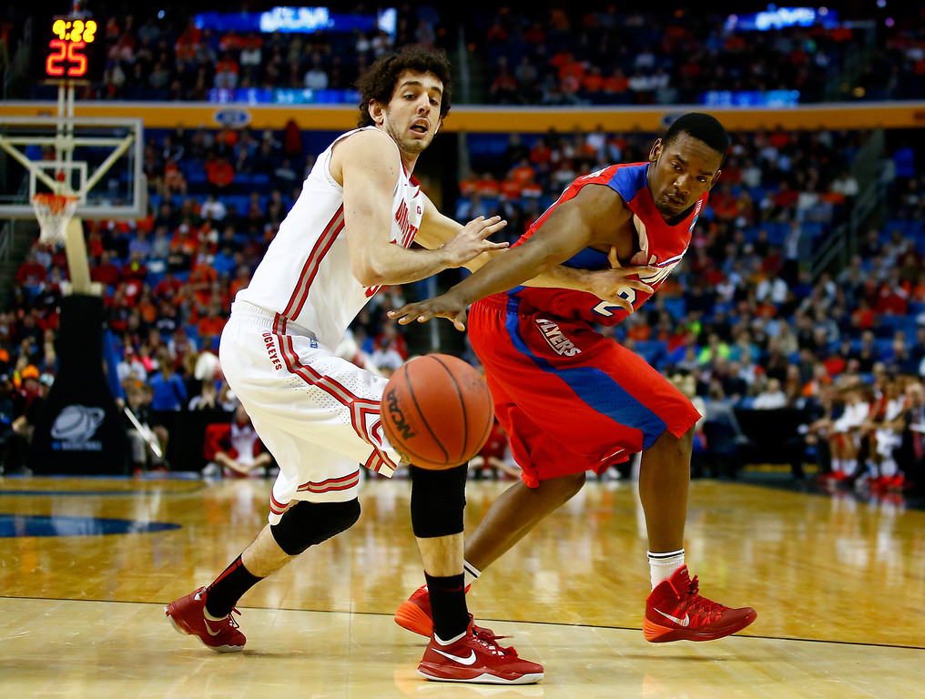 . Amedeo Della Valle #33 of the Ohio State Buckeyes and Dyshawn Pierre #21 of the Dayton Flyers battle for a loose ball during the second round of the 2014 NCAA Men\'s Basketball Tournament at the First Niagara Center on March 20, 2014 in Buffalo, New York.  (Photo by Jared Wickerham/Getty Images)