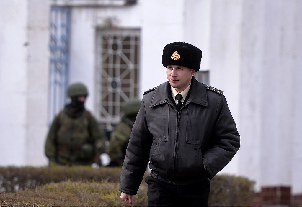 . A Ukrainian officer leaves the Ukrainian navy south headquarters base in Novoozerne after it was taken over by Russian forces on March 19, 2014.  AFP PHOTO/ Filippo MONTEFORTE/AFP/Getty Images
