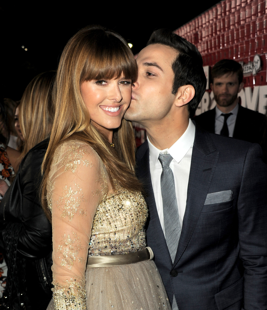 ". Actors Sarah Wright (L) and Skylar Astin arrive at the premiere of Relativity Media\'s ""21 And Over\"" at the Village Theatre on February 21, 2013 in Los Angeles, California.  (Photo by Kevin Winter/Getty Images)"