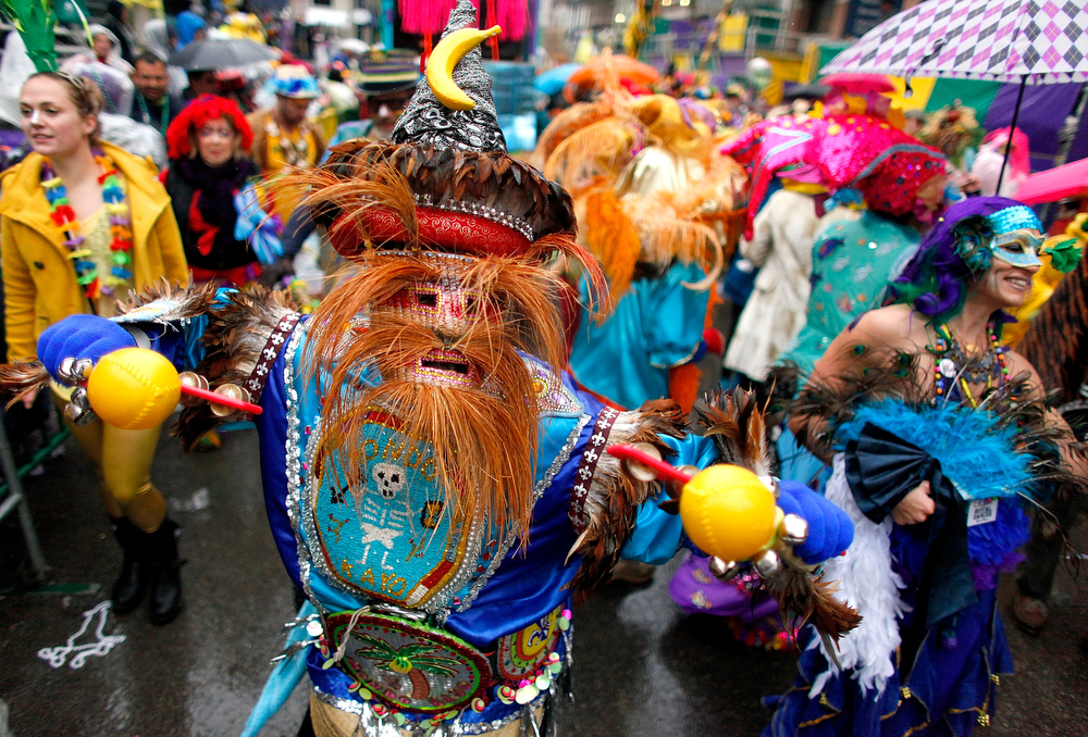 Description of . Members of the Krew of Mondo Kayo Social Marching Club parade Mardi Gras day in the rain on March 4, 2014 in New Orleans, Louisiana.  (Photo by Sean Gardner/Getty Images)