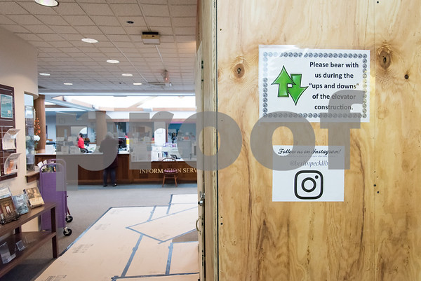 11/8/17 Wesley Bunnell | Staff Wood paneling and signs near the entrance to the Berlin-Peck Library shows where construction is underway on an elevator on Thursday afternoon.