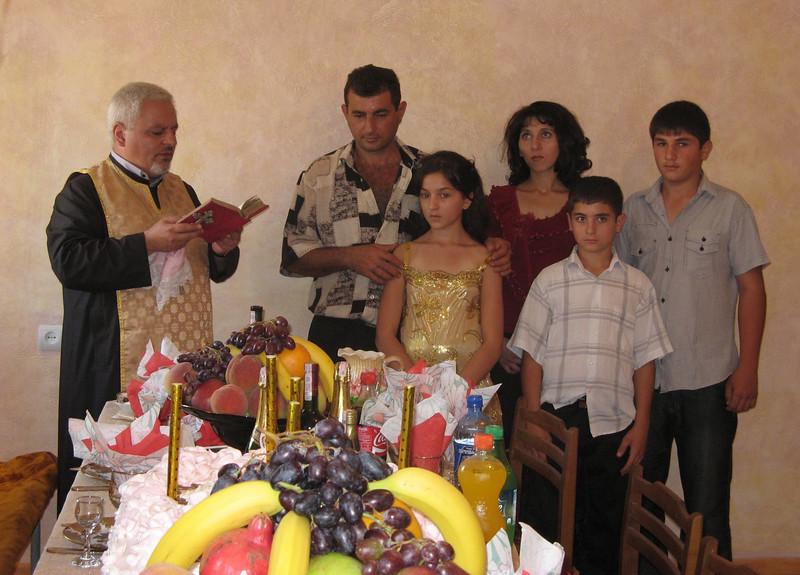 10 09-10  Priest blessing Karapetyans.  gohar