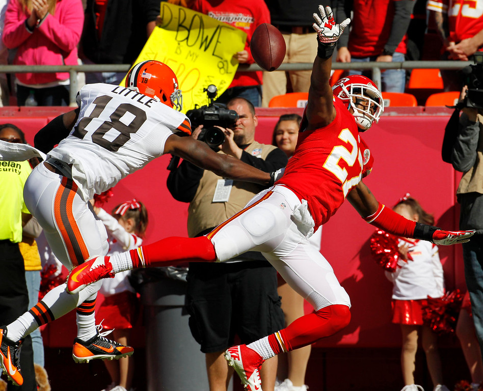 . Cleveland Browns wide receiver Greg Little (18) knocks the ball away from Kansas City Chiefs cornerback Sean Smith (27) to avoid an interception during the first half of an NFL football game in Kansas City, Mo., Sunday, Oct. 27, 2013. (AP Photo/Colin E. Braley)