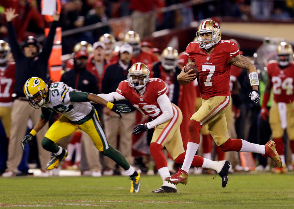 Description of . San Francisco 49ers quarterback Colin Kaepernick (7) runs for a 56-yard touchdown against the Green Bay Packers during the third quarter of an NFC divisional playoff NFL football game in San Francisco, Saturday, Jan. 12, 2013. (AP Photo/Marcio Jose Sanchez)