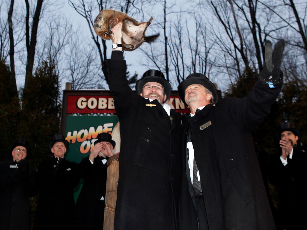 . Ben Hughes, left, and John Griffiths, handlers of the weather predicting groundhog Punxsutawney Phil, hold Phil in the air after removing him from his stump at Gobbler\'s Knob on Groundhog Day, Monday, Feb. 2, 2009, in Punxsutawney, Pa. The Groundhog Club said Phil saw his shadow and predicted six more weeks of winter. (AP Photo/Carolyn Kaster)