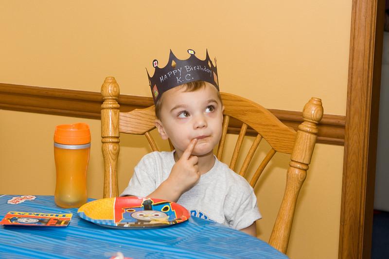 K.C. contemplates more birthday cake.