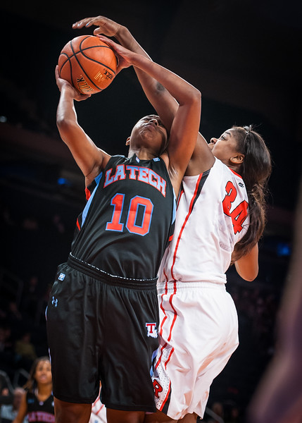 Monique Oliver #34 goes for the block on Brittany Lewis #10
