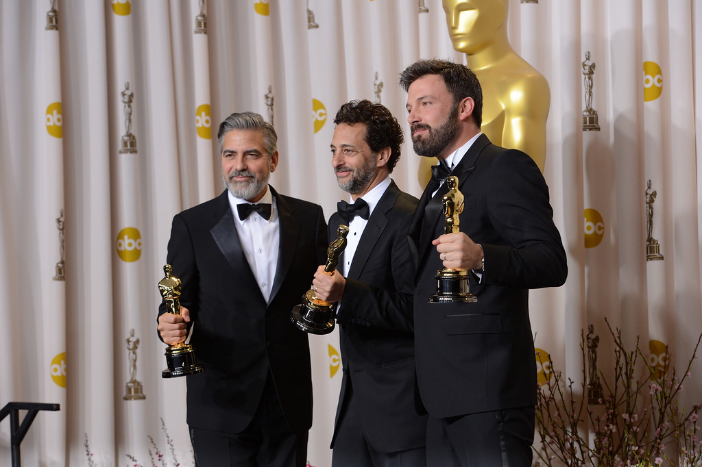 ". George Clooney, Grant Heslov, and Ben Affleck, accepts the award for best picture for ""Argo\""  backstage at the 85th Academy Awards at the Dolby Theatre in Los Angeles, California on Sunday Feb. 24, 2013 ( David Crane, L.A. Daily News)"