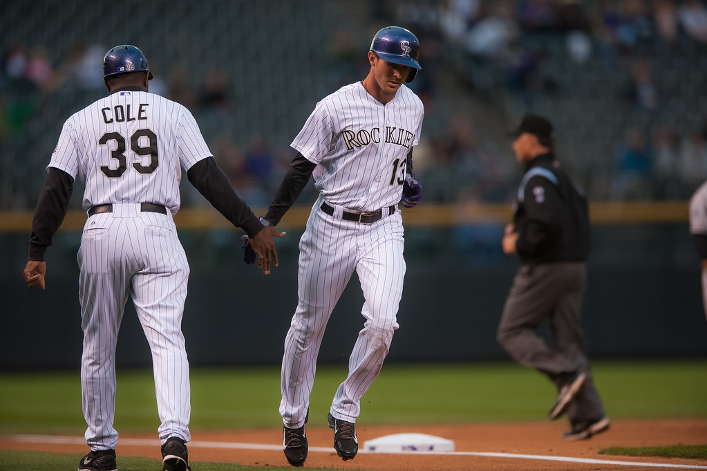 . DENVER, CO - SEPTEMBER 05:  Drew Stubbs #13 of the Colorado Rockies celebrates a solo first inning home run with third base coach Stu Cole #39 during a game against the San Diego Padres at Coors Field on September 5, 2014 in Denver, Colorado.  (Photo by Dustin Bradford/Getty Images)
