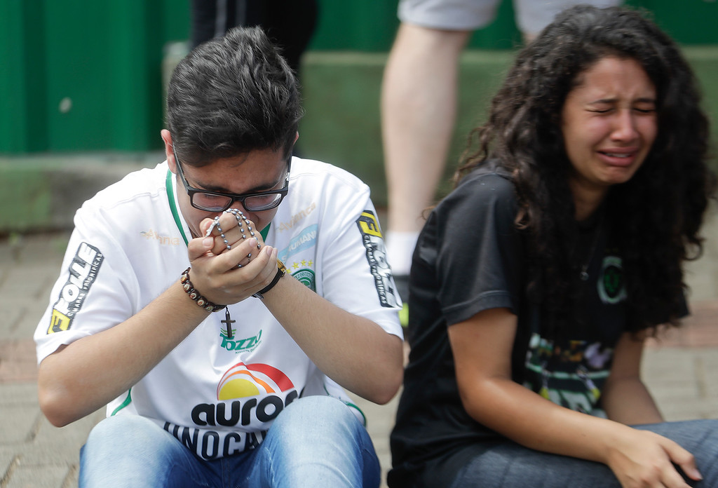 . Supporters of Brazil\'s soccer team Chapecoense mourn outside the Arena Conda stadium in Chapeco, Brazil, Tuesday, Nov. 29, 2016. A chartered plane that was carrying the Brazilian soccer team to the biggest match of its history crashed into a Colombian hillside and broke into pieces, killing 75 people and leaving six survivors, Colombian officials said Tuesday. (AP Photo/Andre Penner)