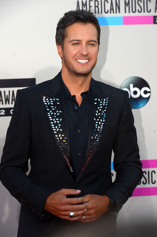 . Luke Bryan arrives to the American Music Awards  at the Nokia Theatre in Los Angeles, California on Sunday November 24, 2013 (Photo by Andy Holzman / Los Angeles Daily News)
