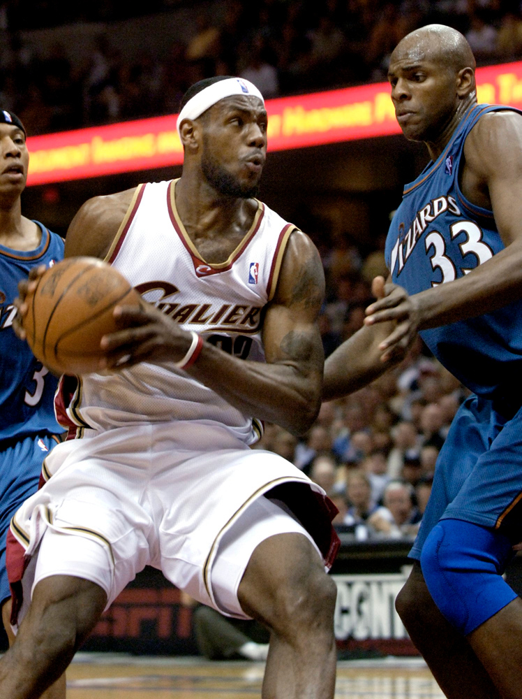 . Jeff Forman/JForman@News-Herald.com LeBron James looks to shoot as Brendan Haywood of the Wizards defends Saturday at the Q Arena.