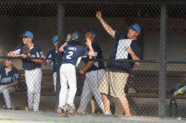 07/09/19 Wesley Bunnell | Staff Southington North vs Southington South in a Little League playoff game on Tuesday July 9, 2019 at Bill Petit Field. Ryan Barnes (2) celebrates in front o this dugout after scoring a run.
