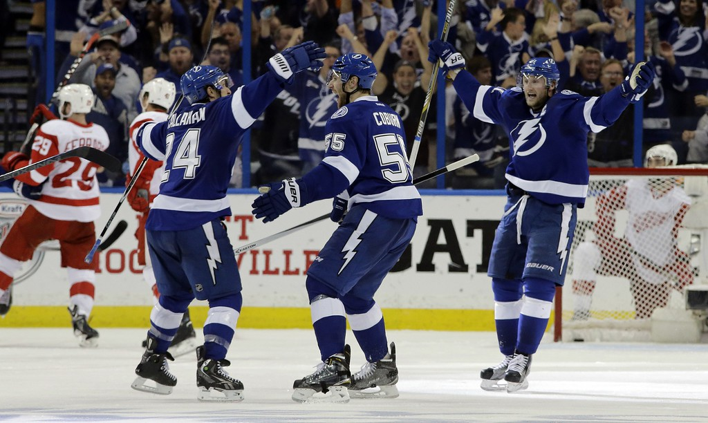 . Tampa Bay Lightning defenseman Braydon Coburn (55) celebrates his goal against the Detroit Red Wings with teammates right wing Ryan Callahan (24) and center Steven Stamkos (91) during the third period of Game 7 of a first-round NHL Stanley Cup hockey playoff series Wednesday, April 29, 2015, in Tampa, Fla. The Lightning won the game 2-0. (AP Photo/Chris O\'Meara)