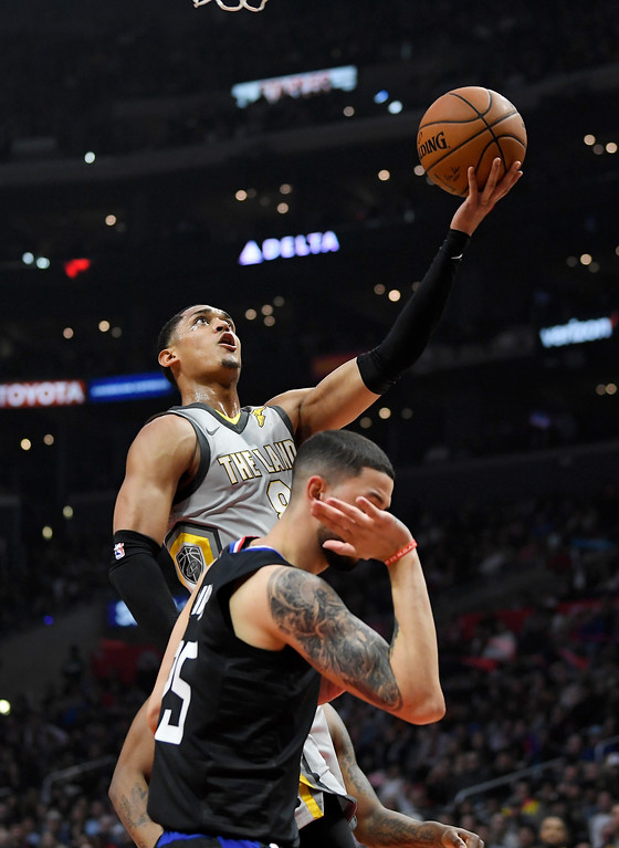 . Cleveland Cavaliers guard Jordan Clarkson, top, shoots as Los Angeles Clippers guard Austin Rivers defends during the first half of an NBA basketball game Friday, March 9, 2018, in Los Angeles. (AP Photo/Mark J. Terrill)