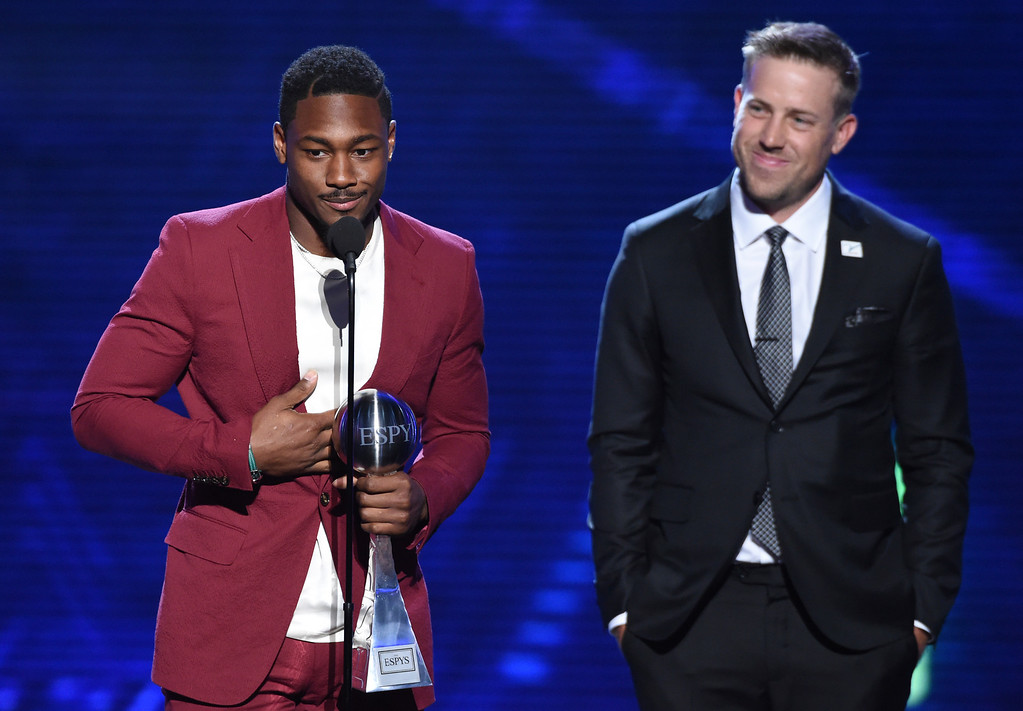 . Minnesota Vikings\' Stefon Diggs, left, and Kirk Cousins accept the award for best moment for the team\'s win over the New Orleans Saints in the NFC championship game, at the ESPY Awards at Microsoft Theater on Wednesday, July 18, 2018, in Los Angeles. (Photo by Phil McCarten/Invision/AP)