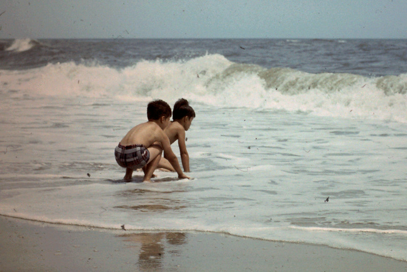 Randy & Jeff play in surf, Outer Banks, NC