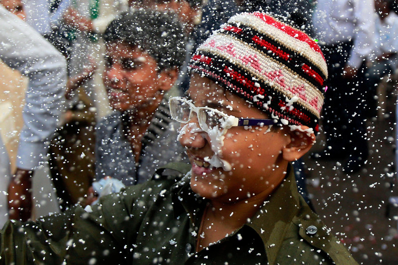 . Foam falls on the face of an Indian Muslim boy walking in a procession of devotees on Eid-e-Milad marking the birth anniversary of the Prophet Muhammad, in Mumbai, India, Tuesday, Jan. 14, 2014. Some thousands of people gather along the streets to chant religious slogans during the annual Eid-e-Milad festival marking the anniversary of Prophet Muhammad\'s birth. (AP Photo/Rafiq Maqbool)
