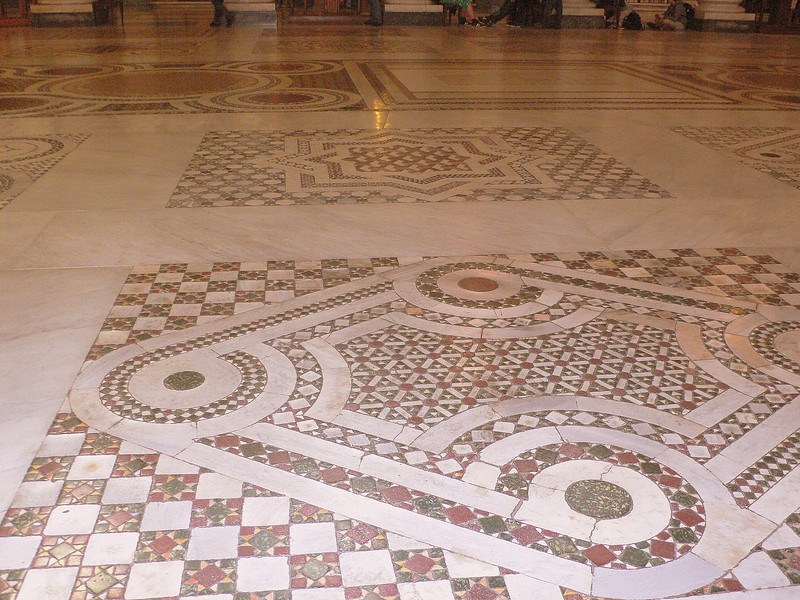 A close-up of the floor of the Basilica Papale di Santa Maria Maggiore.