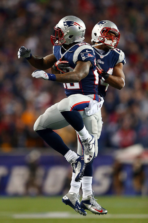 . Stevan Ridley #22 of the New England Patriots celebrates with Shane Vereen #34 after scoring a touchdown in the third quarter against the Houston Texans during the 2013 AFC Divisional Playoffs game at Gillette Stadium on January 13, 2013 in Foxboro, Massachusetts.  (Photo by Elsa/Getty Images)