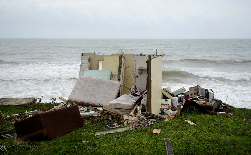 . A completely ruined house is seen in El Negro community a day after the impact of Hurricane Maria, in Puerto Rico, Thursday, September 21, 2017. As of Thursday evening, Maria was moving off the northern coast of the Dominican Republic with winds of 120 mph (195 kph). The storm was expected to approach the Turks and Caicos Islands and the Bahamas late Thursday and early Friday. (AP Photo/Carlos Giusti)