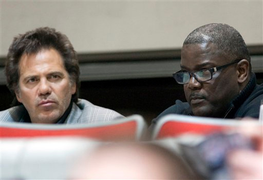 . Detroit Pistons owner Tom Gores, left, and team president Joe Dumars watch the Pistons\' NBA basketball game against the Charlotte Bobcats on Wednesday, Feb. 29, 2012, in Auburn Hills, Mich. The Pistons defeated the Bobcats 109-94. (AP Photo/Duane Burleson)