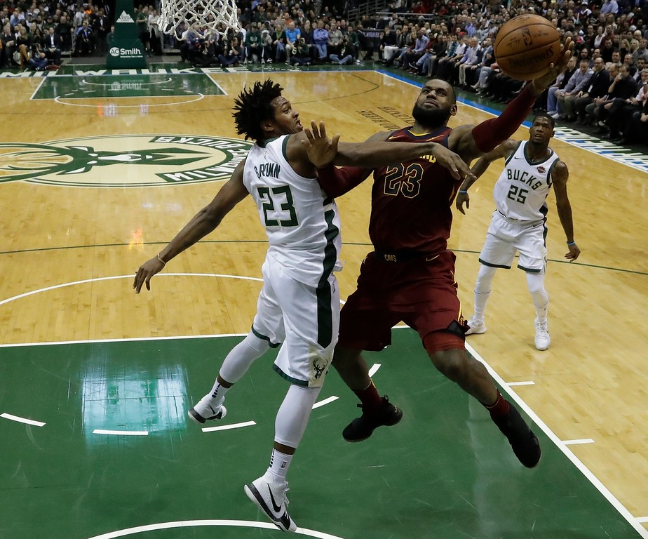 . Cleveland Cavaliers\' LeBron James shoots past Milwaukee Bucks\' Sterling Brown during the first half of an NBA basketball game Tuesday, Dec. 19, 2017, in Milwaukee. (AP Photo/Morry Gash)