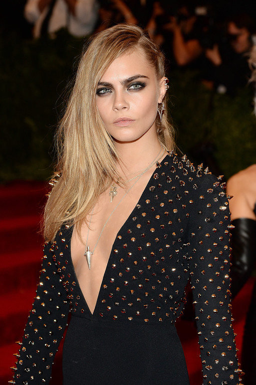 """. Cara Delevingne attends the Costume Institute Gala for the \""""PUNK: Chaos to Couture\"""" exhibition at the Metropolitan Museum of Art on May 6, 2013 in New York City.  (Photo by Dimitrios Kambouris/Getty Images)"""