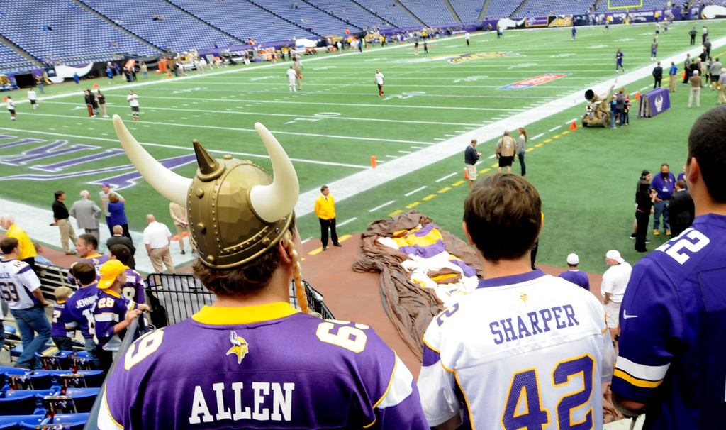 """. From left: Justin Morken, Ethan Ryan and Kevin Brown watch pregame warm -ps at the Metrodome. Morken added that \""""I will probably cry when they tear it down. They (Vikings) are tearing it down on my 21st Birthday in February.\"""" (Pioneer Press: Sherri LaRose-Chiglo)"""