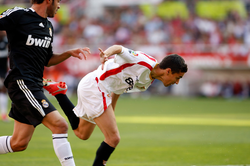 Jesus Navas (Sevilla) struggling with Miguel Torres (Real Madrid). Spanish Liga football game between Sevilla FC and Real Madrid CF that took place at Sanchez Pizjuan stadium, Seville, Spain, on 26 April 2009