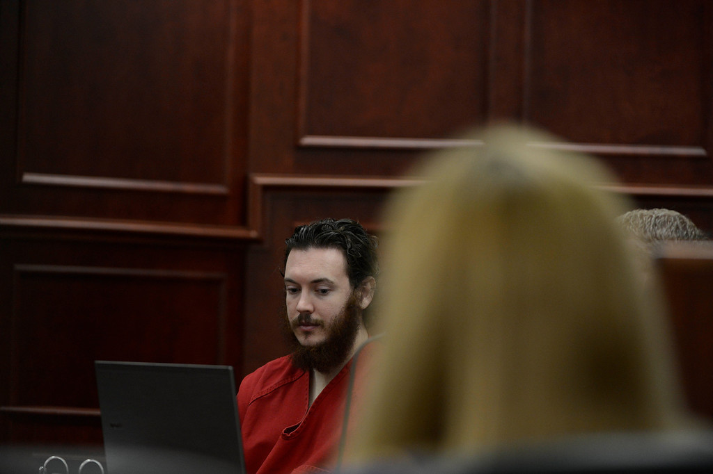 . James Holmes stares blankly at advisement paperwork during a hearing Tuesday morning June 04, 2013 at the Arapahoe County Justice Center. Holmes is accused of killing 12 people and injuring 70 others in a shooting rampage at an Aurora theater, July 20th, 2012. The court accepted James Holmes plea of not guilty by reason of insanity and has ordered a sanity evaluation at the Colorado Mental Health Institute of Pueblo. (Photo By Andy Cross/The Denver Post)