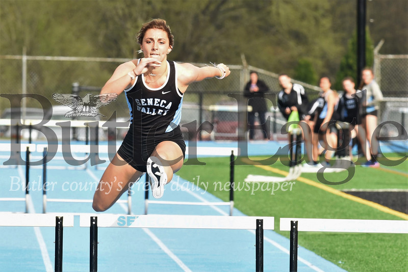 Seneca's Lauren Chappelle  pushes to down the final stretch of the 300 meter hurdles Tuesday against Butler. Chappelle took second in the event. She finished first in the 100 meter hurdles, breaking a school record. Seb Foltz/Butler Eagle