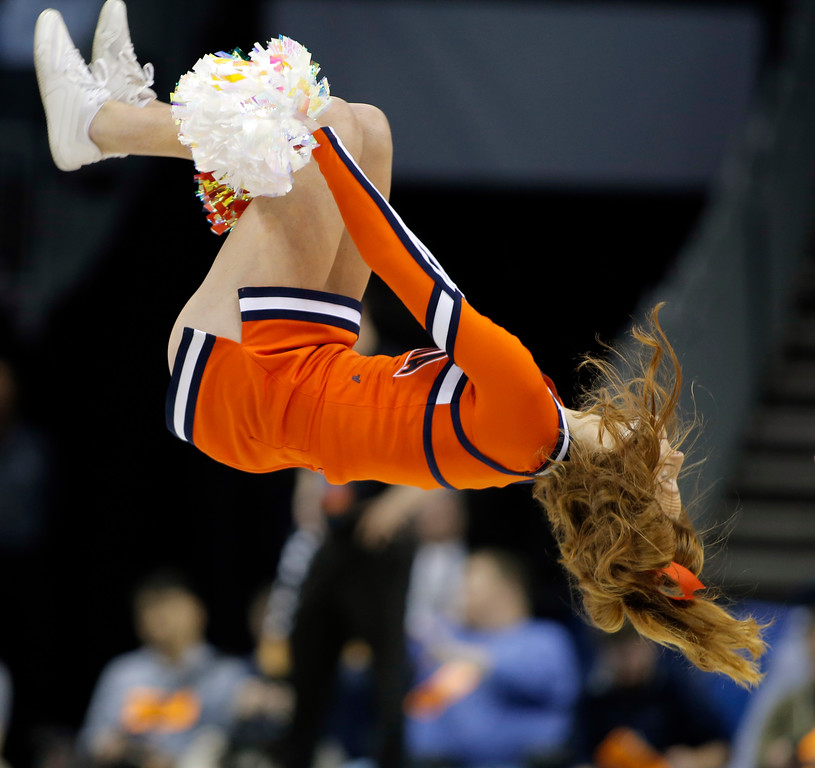 . A Virginia cheerleader performs during the first half of a first-round game against UMBC in the NCAA men\'s college basketball tournament in Charlotte, N.C., Friday, March 16, 2018. (AP Photo/Bob Leverone)