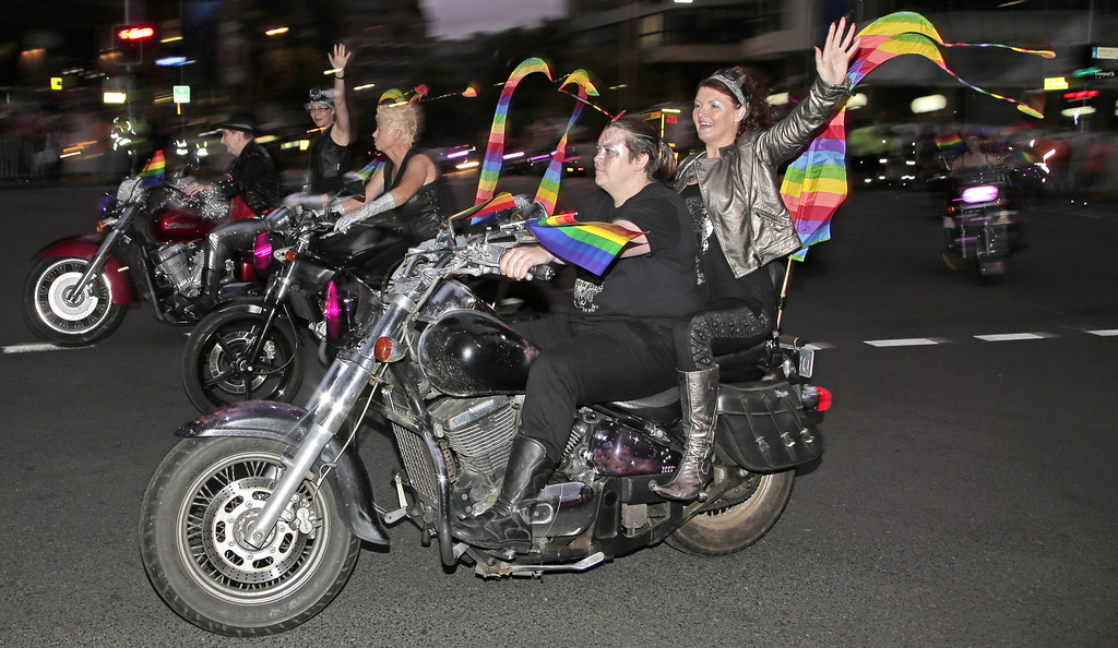 ". Parade participants called ""Dykes on Bikes\"" take their traditional place at the head of the Mardi Gras Parade in Sydney, Australia, Saturday, March 2, 2013. 10,000 are marching along side 115 floats in the annual parade that celebrates lesbian and gay pride. (AP Photo/Rick Rycroft)"