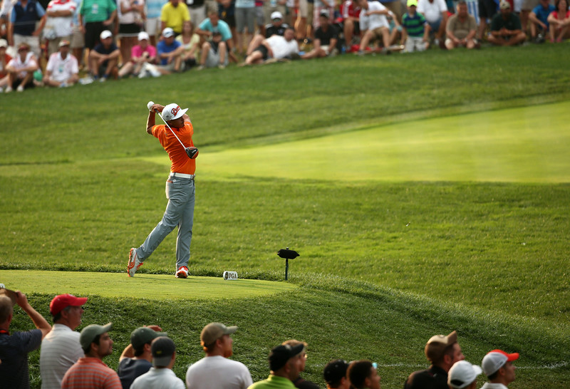 . Rickie Fowler of the United States hits his tee shot on the 15th hole during the final round of the 96th PGA Championship at Valhalla Golf Club on August 10, 2014 in Louisville, Kentucky.  (Photo by Warren Little/Getty Images)