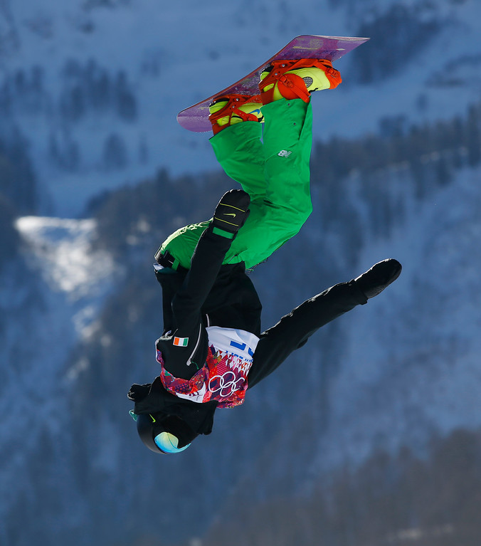. Ireland\'s Seamus O\'Connor takes a jump during the men\'s snowboard slopestyle qualifying at the Rosa Khutor Extreme Park ahead of the 2014 Winter Olympics, Thursday, Feb. 6, 2014, in Krasnaya Polyana, Russia.  (AP Photo/Sergei Grits)