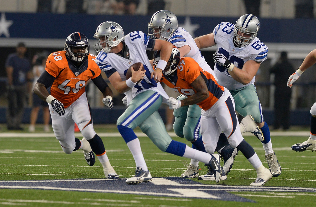 . ARLINGTON, TX - AUGUST 28: Denver Broncos defensive back Lou Young (39) sacks Dallas Cowboys quarterback Dustin Vaughan (10) during the fourth quarter August 28, 2014 at AT&T Stadium. (Photo by John Leyba/The Denver Post)