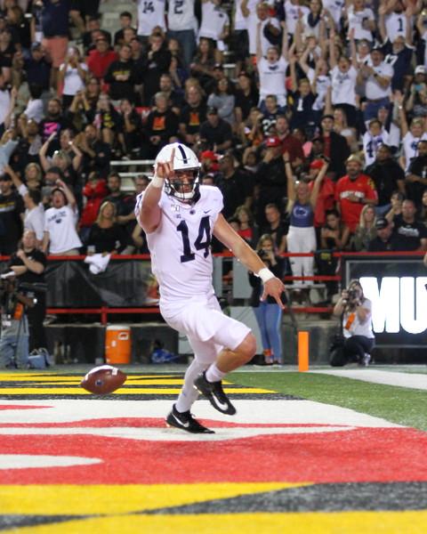 Penn State QB #14 Sean Clifford celebrates after a touchdown