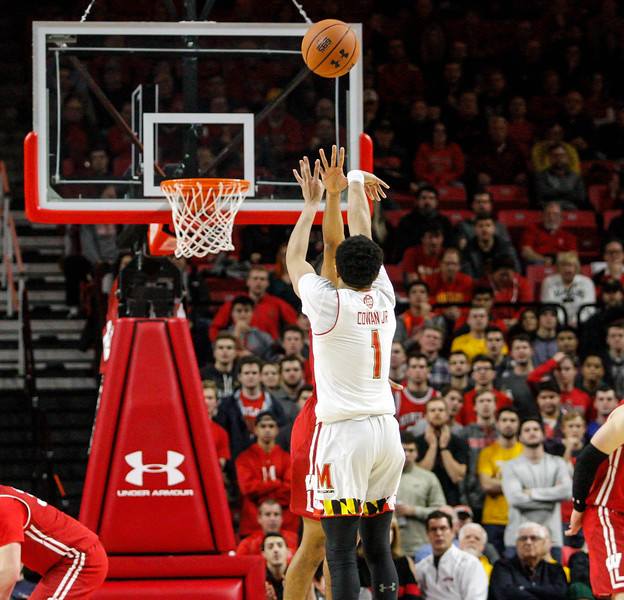 January 20, 2018: Maryland guard Anthony Cowan (1) shoots a three to give Maryland the lead late in the game during BIG Ten Men Basketball action between University of Wisconsin and University of Maryland in College Park. Photo by: Chris Thompkins/Prince Georges Sentinel