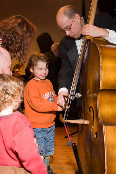 David Freiman, bass, with child -- Hopkins Symphony Orchestra, March 2008