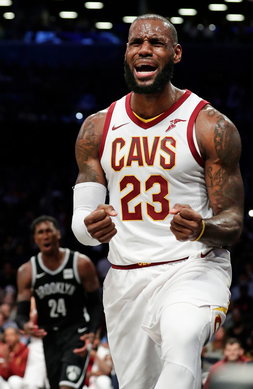 . Cleveland Cavaliers\' LeBron James (23) reacts after a foul as Brooklyn Nets\' Rondae Hollis-Jefferson (24) watches during the first half of an NBA basketball game Wednesday, Oct. 25, 2017, in New York. (AP Photo/Frank Franklin II)