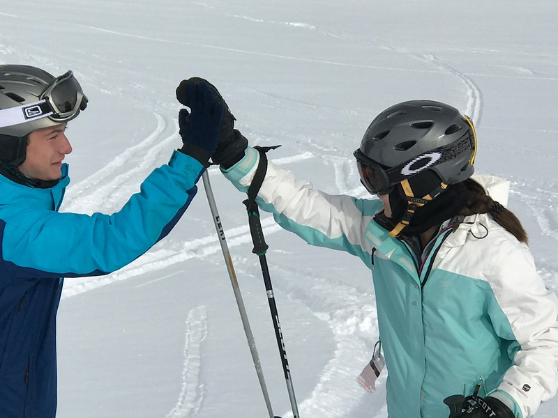 Michael and Whitney high fiving their powder experience