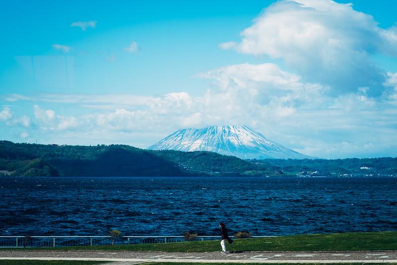 A Woman Walks Beneath Mount Yōtei