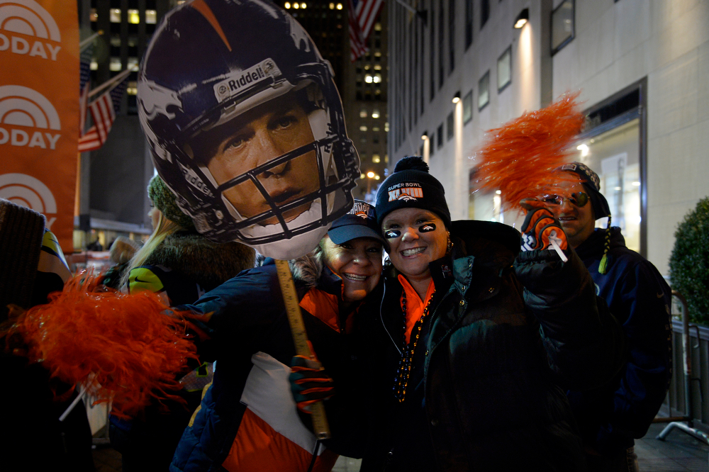 . Heather Dean and Robin Gilchrist cheer for the Broncos as they wait for Thunder to show up at the Today Show on January 31, 2014, New York, NY. (Photo By Joe Amon/The Denver Post)