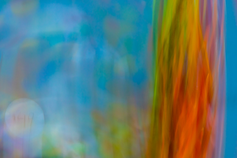 A rainbow riot of colors dances across this abstract image