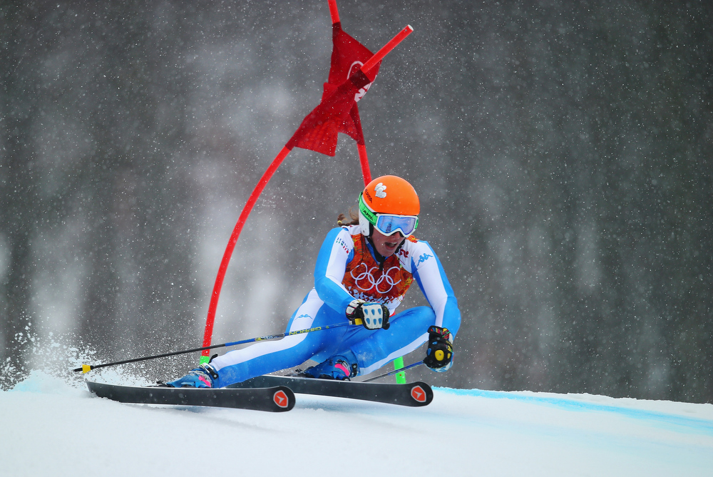 Description of . Nadia Fanchini of Italy makes a run during the Alpine Skiing Women's Giant Slalom on day 11 of the Sochi 2014 Winter Olympics at Rosa Khutor Alpine Center on February 18, 2014 in Sochi, Russia.  (Photo by Clive Rose/Getty Images)