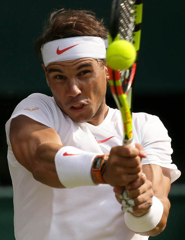 . Rafael Nadal of Spain returns the ball to Czech Republic\'s Jiri Vesely during their men\'s singles match, on day seven of the Wimbledon Tennis Championships, in London, Monday July 9, 2018. (AP Photo/Tim Ireland)