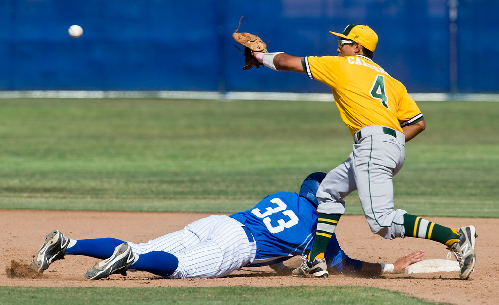 . Amat\'s Bryan Menendez (#33) slides back to second in the sixth inning during quarterfinal baseball, Mira Costa at Bishop Amat on Friday, May 24, 2013. Mira Costa won 4-2. (SGVN/Staff photo by Watchara Phomicinda)