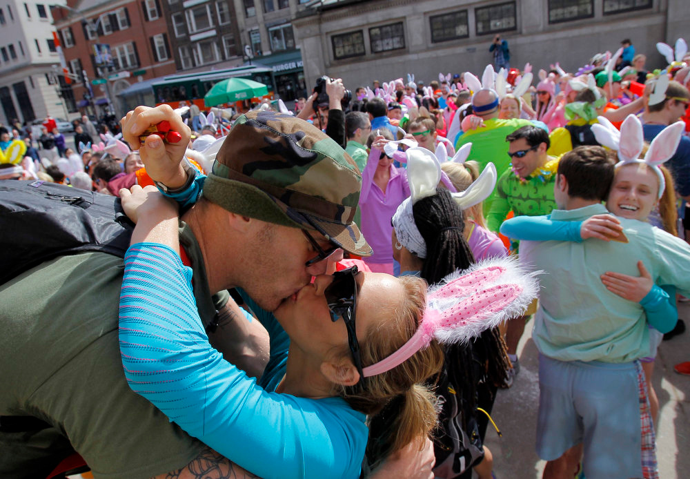 . Brogan Graham (L) kisses his girlfriend Goldie Kaufenbergh at the starting line of an Easter Fun Run put on by the November Project in Boston, Massachusetts March 31, 2013. The November Project is a free fitness community that hosts weekly workouts in Boston. REUTERS/Jessica Rinaldi