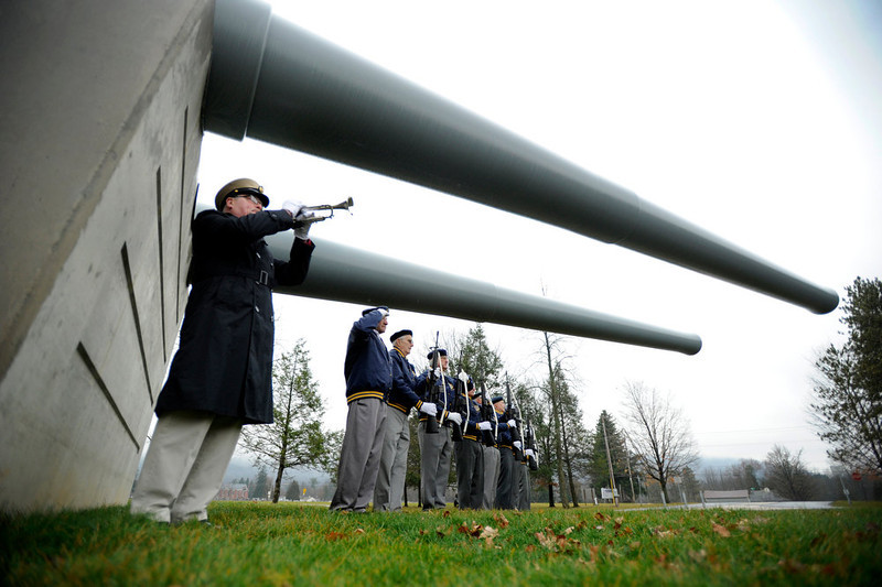 """. Dave Strouse, a volunteer for the State College American Legion, plays \""""taps\"""" during a Pearl Harbor Remembrance Day and ceremony at the Pennsylvania Military Museum, in Boalsburg, Pa., Friday, Dec. 7, 2012 is   (AP Photo/Centre Daily Times, Nabil K. Mark)"""